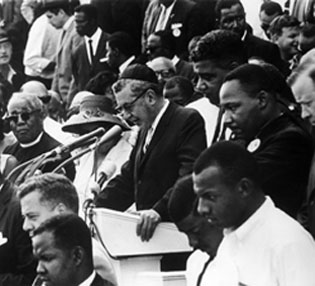 "August 28, 1963 -- George Raveling, lower right, as MLK delivers his famous ""I Have A Dream"" speech during the March on Washington"